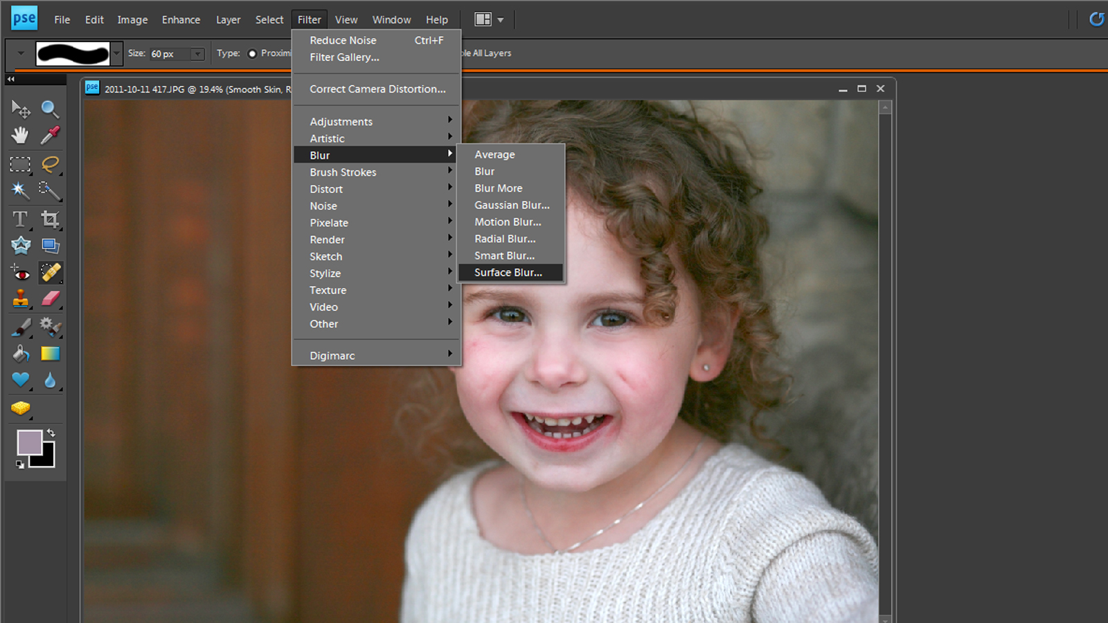 Tutorial smoothing skin in photoshop elements it works for bobbi filter which will smooth and kind of blur the entire photo dont worry about that well be fixing it soon so click at the top of the screen on baditri Choice Image